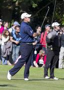 SURRY, ENGLAND - MAY 29: Lee Westwood plays through hole 18 golf - stock photo