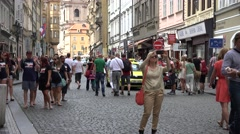 ULTRA HD 4K Tourist people enjoy commercial road Prague take photo emblem iconic Stock Footage