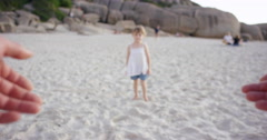 Father swinging daughter around on the beach at sunset having fun POV Stock Footage