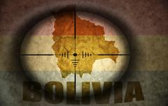 Sniper scope aimed at the vintage bolivian flag and map Stock Illustration