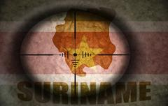 Stock Illustration of sniper scope aimed at the vintage surinamese flag and map