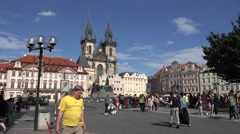 ULTRA HD 4K Tourist people visit old town public square Tyn church Prague emblem Stock Footage