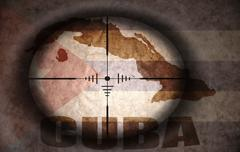 Stock Illustration of sniper scope aimed at the vintage cuban flag and map