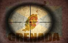 sniper scope aimed at the vintage grenada flag and map - stock illustration
