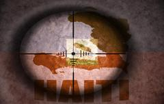 sniper scope aimed at the vintage haitian flag and map - stock illustration
