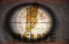 Sniper scope aimed at the vintage belize flag and map Stock Illustration