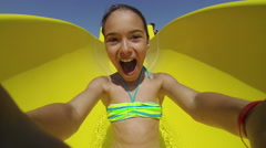 Child sliding down water slide in pool. Close up - stock footage