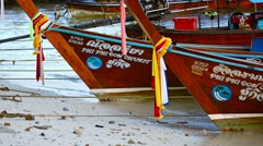 Wooden boats with decorations, along a beach on Phi Phi Island in Thailand Stock Footage