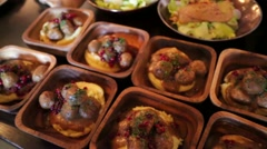 Dishes with mashed potatoes, meatballs and berries on a buffet table Stock Footage
