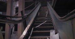 Broken facilities of former shopping mall. Destroyed escalator in empty room Stock Footage