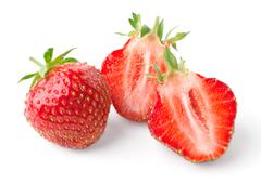 Whole strawberry and strawberry cut in half - stock photo