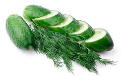 Sliced cucumber and dill - stock photo