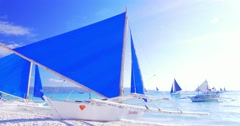 Traditional wooden yacht boat with blue sail on sea shore beach - stock footage