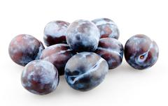Handful of black plums Stock Photos