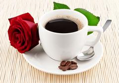 Cup of coffee and red rose Stock Photos
