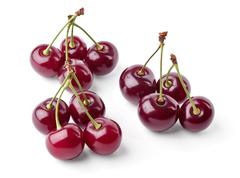 Three groups of juicy cherries view from top Stock Photos