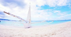 White sail boat on sandy beach of tropical Boracay island in Philippines  Stock Footage