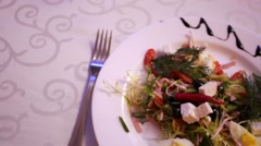 Delicious garden salad served in a restaurant Stock Footage