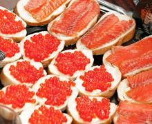 Sandwiches caviar and fish Stock Photos