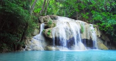 Exotic landscape with idyllic waterfall in tropical rainforest of Thailand Stock Footage
