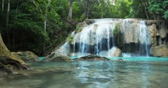 idyllic waterfall and serene environment of wild tropical forest in Thailand - stock footage