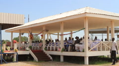 LEADERS SIT UNDER SHADE AT POLITICAL RALLY IN SOUTH SUDAN, AFRICA Stock Footage