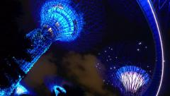 Illuminated Sparkling Supertrees by Night at Gardens By The Bay Singapore Stock Footage