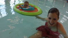 Families at the public swimming pool inside Stock Footage