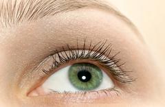 Beautiful woman green eye close-up - stock photo