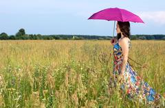 Beautiful woman with color umbrella - stock photo