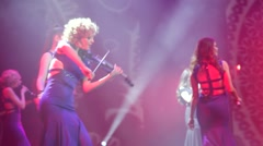 Women perform on a stage during concert show Stock Footage