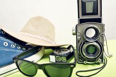 Twin-lens reflex camera with sneaker Stock Photos