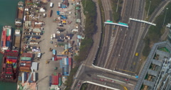 Industrial timelapse video of Hongkong container terminal and highway traffic Stock Footage