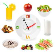 Clock with healthy diet healthy food - stock photo