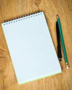 Notebook, pen and pencil on wood background Stock Photos