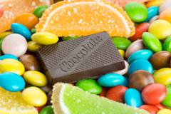 Mixed colorful sweets background - stock photo