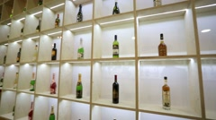 Wine, champagne and cognac bottles - stock footage