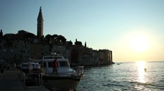 Boats moored in Rovinj at sunset Stock Footage