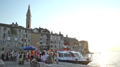 People on dock in Rovinj at sunset Stock Footage