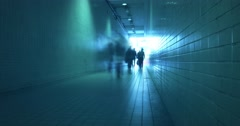 Blurred people walk through long tunnel timelapse video  Stock Footage