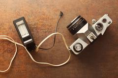 Old analogue camera with flash Stock Photos