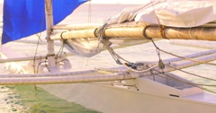 White wooden yacht boat with blue sail on sea shore. Beautiful nautical video - stock footage