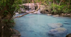 Crystal clear natural pool pond with transparent turquoise water in wild jungle Stock Footage