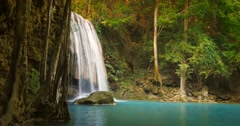 Tracking slider video of idyllic waterfall in tropical forest. Beautiful nature  - stock footage