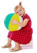 little girl in a red dress with polka dots - stock photo