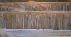 Close up view of waterfall cascades with smooth silky water flows seamlessly Stock Footage