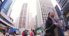 Pedestrians in downtown of Hongkong walk on street at day time Stock Footage