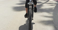 Closeup of young woman riding bike Stock Footage