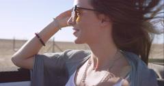 Beautiful girl on adventure road trip in vintage convertible enjoying the wind Stock Footage