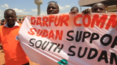 SUPPORT DARFUR BANNER AT POLITICAL RALLY IN SOUTH SUDAN, AFRICA Stock Footage